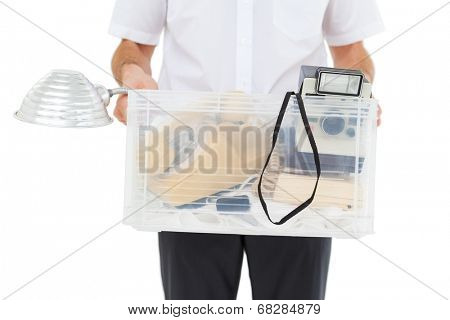 Businessman holding box of his things on white background