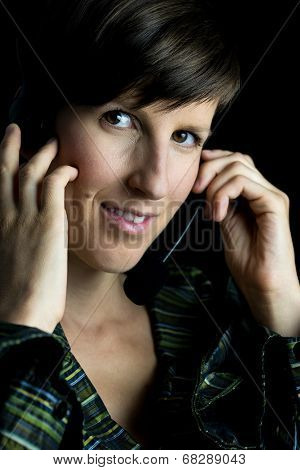 Friendly Woman Using Headset With Headphones