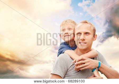 Father with little son portrait on the ky background