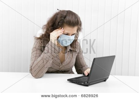 The Young Woman In Medical Mask With The Laptop