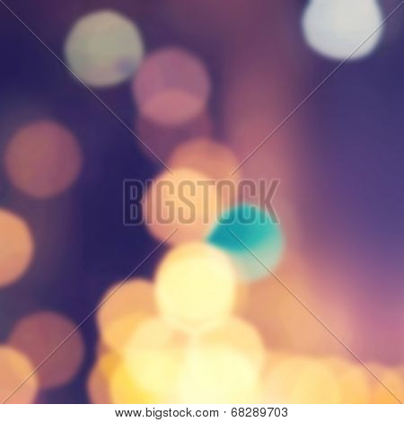 Abstract Bokeh Christmas  Background. Elegant Vintage Texture With Gold And Purple De Focused Lights