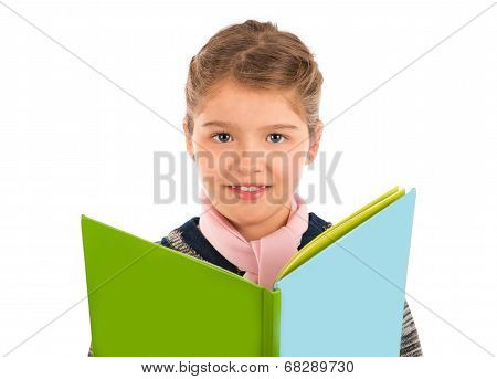 Little Girl Holding A Green And Blue Story Book