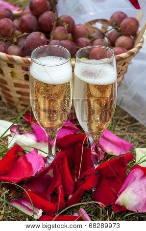 Wedding Glasses Of Champagne On Background Basket With Grapes