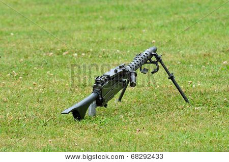 Machine gun lying on the ground