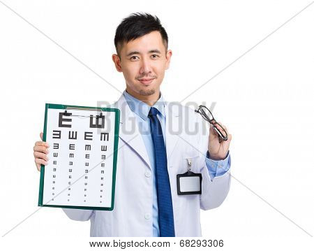 Oculist hold with eye chart and glasses