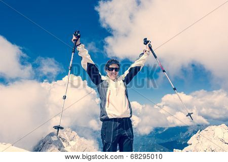 Young Woman Celebrating On Top Of A Mountain