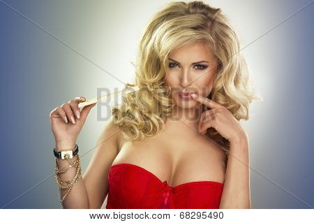 Portrait Of A Blonde Young Woman Biting White Chocolate