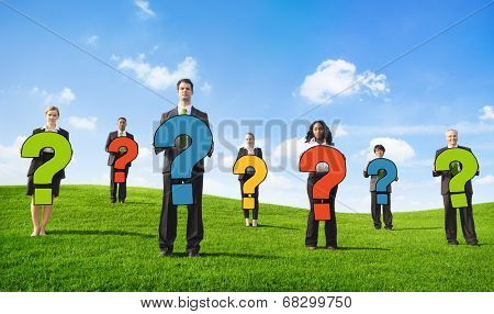 Angry Business People Outdoors Holding Question Marks