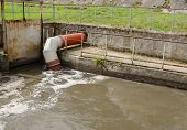 stock photo of waste reduction  - All city sewage waste water and garbage flow through pipe tube toward water cleaning treatment stages - JPG
