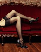 pic of stocking-foot  - Beautiful long legs of a nude woman in erotic black stockings - JPG