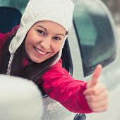 stock photo of driving school  - Smiling young pretty woman in the car  - JPG