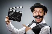 picture of clapper board  - Funny man with movie clapper board  - JPG