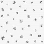 stock photo of animal footprint  - Seamless animal pattern of paw footprint - JPG