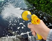 pic of soapy  - Car care - Woman using a garden spray gun to remove the soap