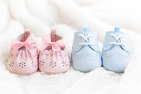 stock photo of twin baby  - Baby shoes for a boy and a girl - JPG