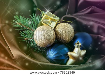 Beautiful Christmas balls on satin cloth