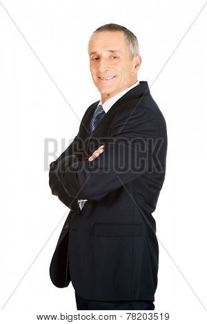 Side view of businessman with folded arms.