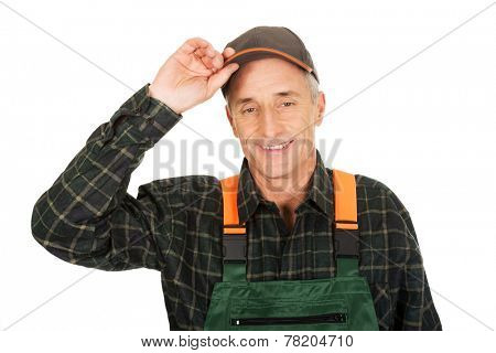 Experienced smiling gardener with protective hat