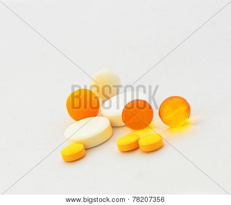 Tablets And Dragees On A White Background