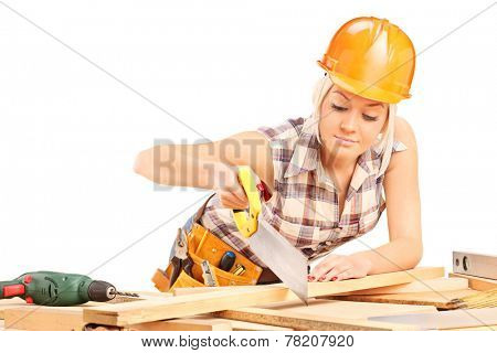 Female carpenter cutting plank with a handsaw isolated on white background