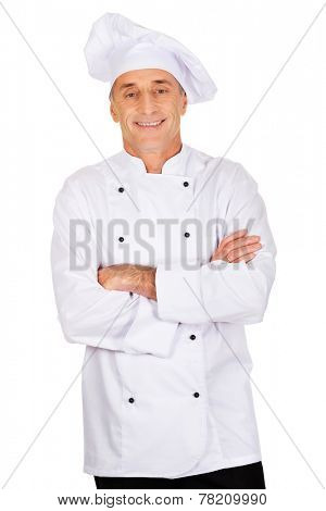 Restaurant experienced chef standing with folded arms