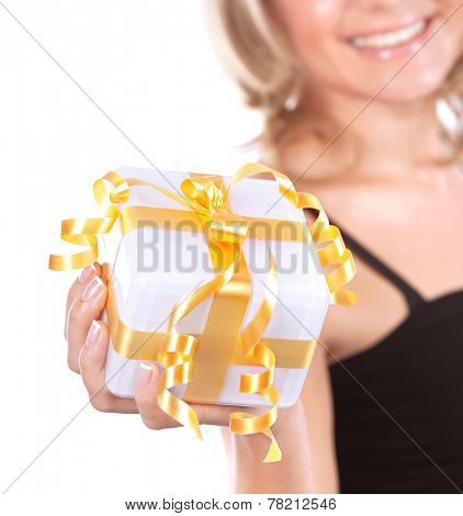 Cute girl with gift box isolated on white background, soft focus of female face part, enjoying Christmas present concept