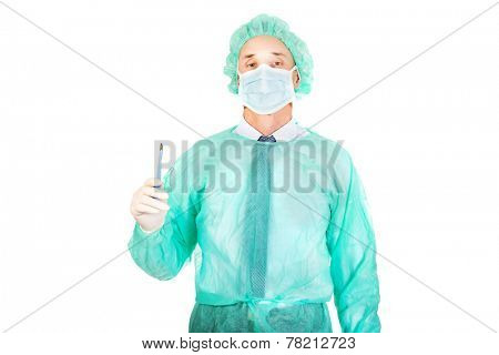Portrait of male doctor with a scalpel.