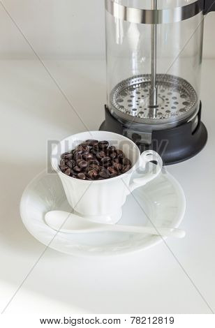 Coffee Beans in Cup and French Press Coffee