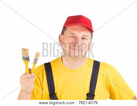 Worker shows painting brush.