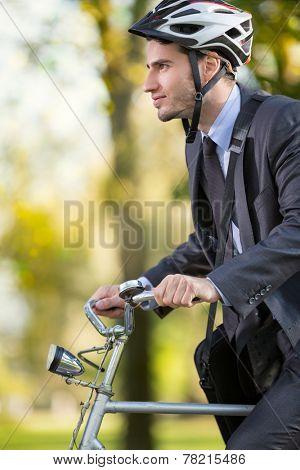 young businessman in suit wearing bike helmet go to work