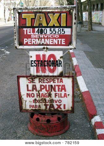 Latin taxi street Sign