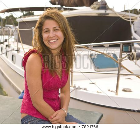 Smiling Girl Siting Next To A Boat With Copy Space
