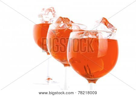 red wine and ice cubes on white