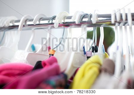Colorful Closeup Of Child Clothes Rack