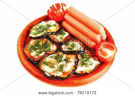 sausages served on wooden plate with grilled eggplant