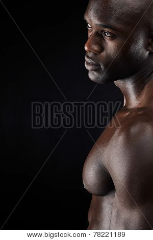Man Standing Shirtless In The Studio