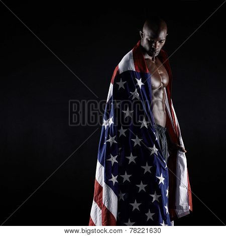 Male Athlete Carrying An American Flag