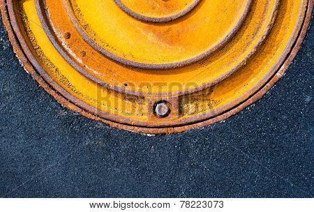 Rusty Metal Manhole Cover