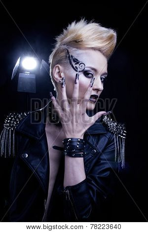Fashion Rocker Style Model Girl Portrait. Hairstyle. Rocker or Punk Woman Makeup, Hairdo and black N