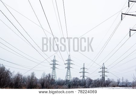 Electricity Pylons And Power Lines In The Winter Day