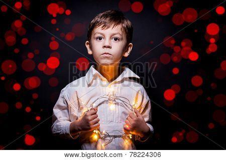Boy Portrait Whit Christmas Lights