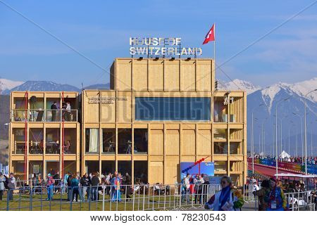 SOCHI, RUSSIA - FEBRUARY 12, 2014: People near the House of Switzerland in the Olympic park during Winter Olympics. Russia hosted the second Olympics in history
