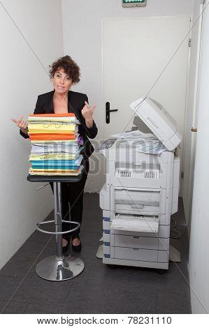 business woman using a copy machine