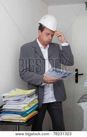 business man looking at his document