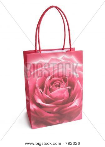 pink brightly colored shopping bag isolated over a white backgro