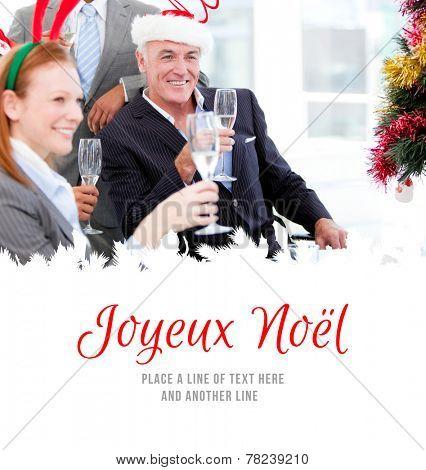 Businessman team celebrating christmas against joyeux noel