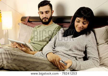 Woman In Bed Texting Message Boyfriend Jealous Looking