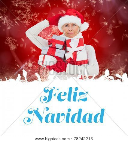 festive woman holding gifts against feliz navidad