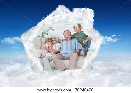 Smiling grandchildren embracing their grandparents against bright blue sky over clouds