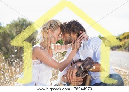 Handsome man serenading his girlfriend with guitar against house outline